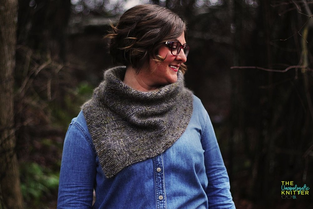 A fingering weight mohair marled cowl featuring slipped stitches.