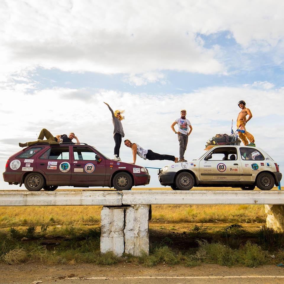 Global Convoy Team.    After completing the equally ridiculous Mongol Rally in 2015, two members from separate teams decided they hadn't had enough. After some incredibly brief planning and a vague agreement that this was probably feasible, the Global Convoy Team was born.    The mission? Fully circumnavigating the world in vehicles that would struggle to make it to the local park and back. To add to the challenge an impractically small budget was set, planning and research kept to a minimum and the project was fully opened up to the public. Around 50 people and 25 countries later the first month was complete! Describing it as addicting doesn't come close to doing it justice.    The Global Convoy Team will be talking to us about their incredible adventures around the world, and also bringing along a couple of their famed vehicles to admire    www.globalconvoy.com