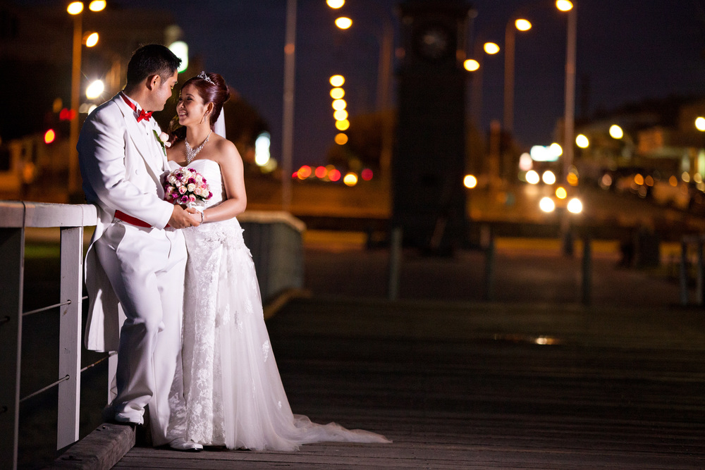 bride and groom in adelaide beach jetty