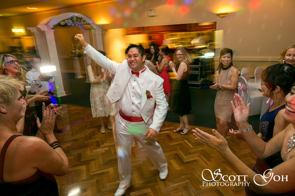happy groom dancing
