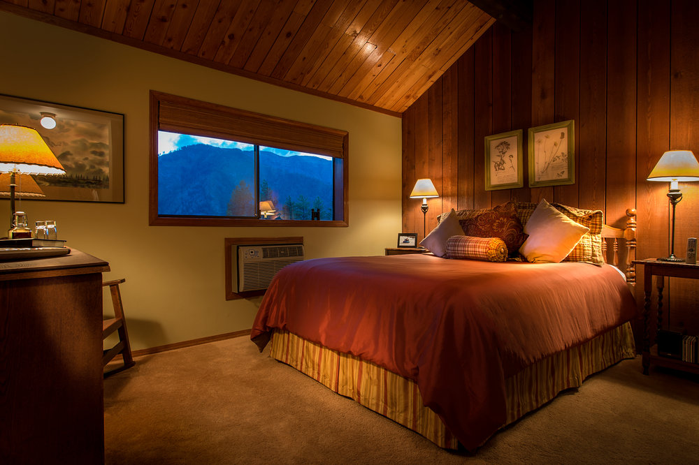 The Mountain View - A gorgeous view of the Cascades with a queen bed and vaulted pine ceiling.