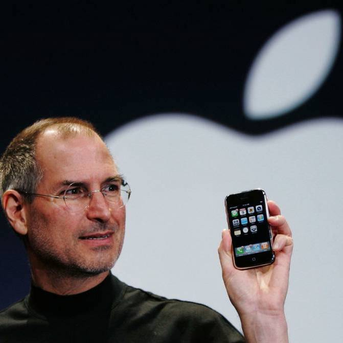Jobs holding iPhone.jpeg