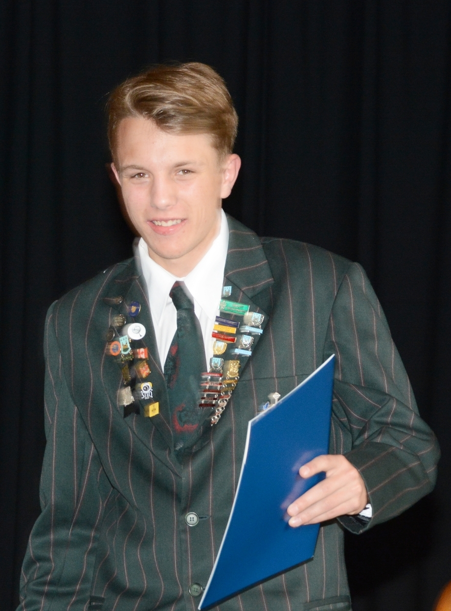 Outstanding Staples Scholarship recipient, Liam Jacobson, at Dilworth's end of year Senior School Prize Giving....the badges say it all.
