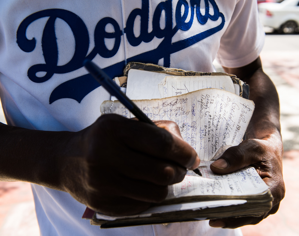 Due to the lack access to technology, Tony carries around a notebook where he has information that is important to him. From phone numbers to statistics, Tony keeps all his information in one place. While showing me his notebook, he also showed me some of the images he keeps in it such as photos of MLB players that he says people bring him.