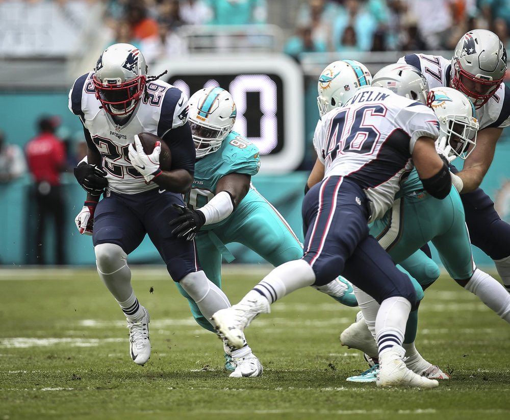 New England Patriots running back LeGarrette Blount (29) breaks loose of a tackle by Miami Dolphins defensive tackle Earl Mitchell (90). Blount rushed for 44 yards on 9 carries against the Dolphins at Hard Rock Stadium in Miami Gardens, Florida, January 1, 2017.