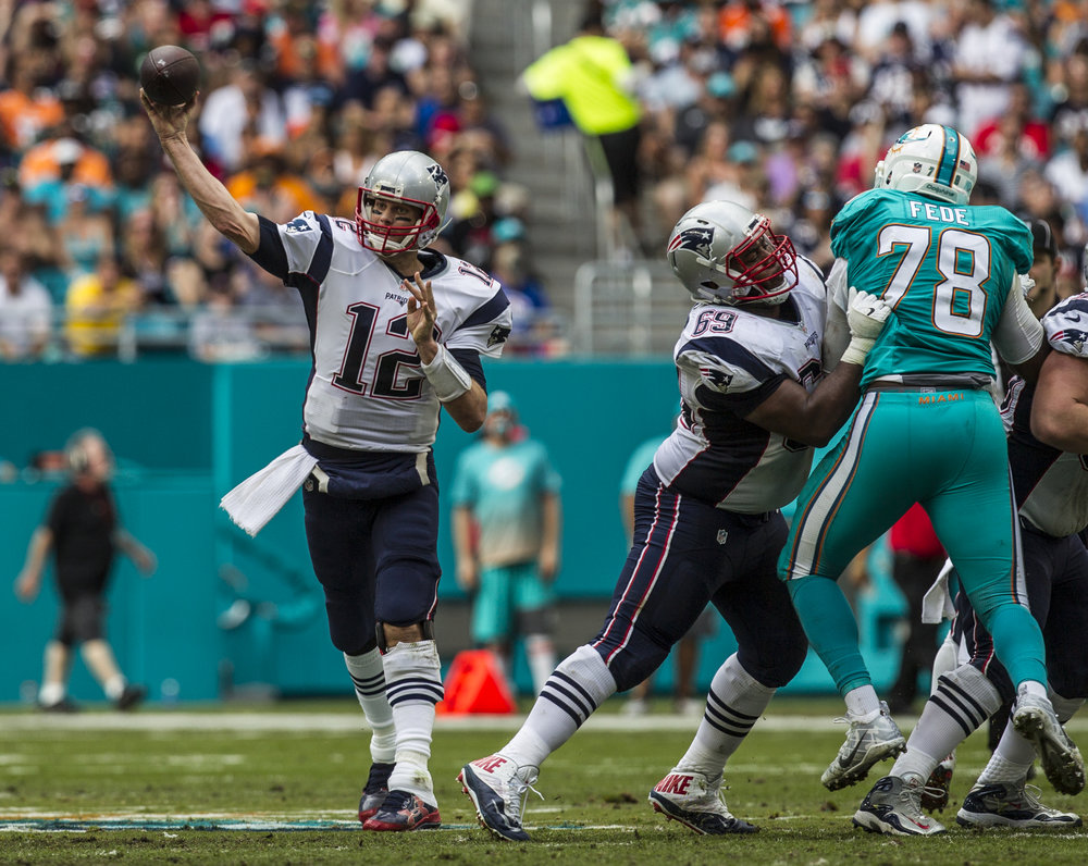 New England Patriots quarterback Tom Brady (12) attempts to complete a pass at Hard Rock Stadium in Miami Gardens, Florida, January 1, 2017. Brady finished with 273 yards and 3 touchdowns in the 35-14 win over the Dolphins.