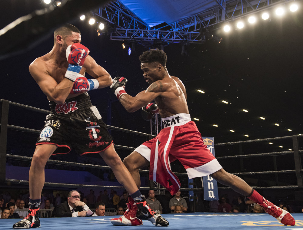 Alex Martin throws a hook in his fight against Robert Daniels Jr. at Hialeah Casino Park.