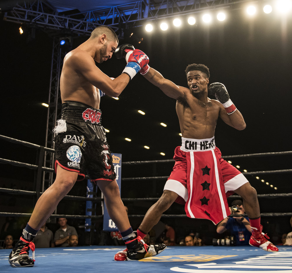 Alex Martin throws a jab in his fight against Robert Daniels Jr. at Hialeah Casino Park.