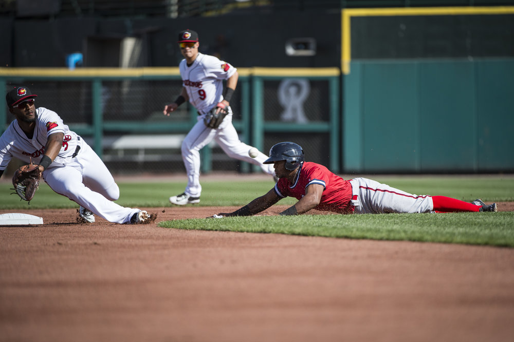 Rafael Bautista steals a base during a Chiefs game against the Rochester Red Wings at Rochester on April 16th, 2017. Bautista is known for his speed. Before getting called up to the Nationals, he led the Chiefs with 3 stolen bases. Last year in Double A with the Harrisburg Senators, he led all of minor league baseball with 56 stolen bases, with a 84% success rate.