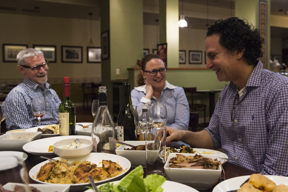Roberto shares a laugh with his wife, Elizabeth Turnbull, and co-worker, Doug Addington, after the Saturday dinner shift ends. One Saturday's, Roberto serves all the leftover food so that his team members can have a nice meal before going home.