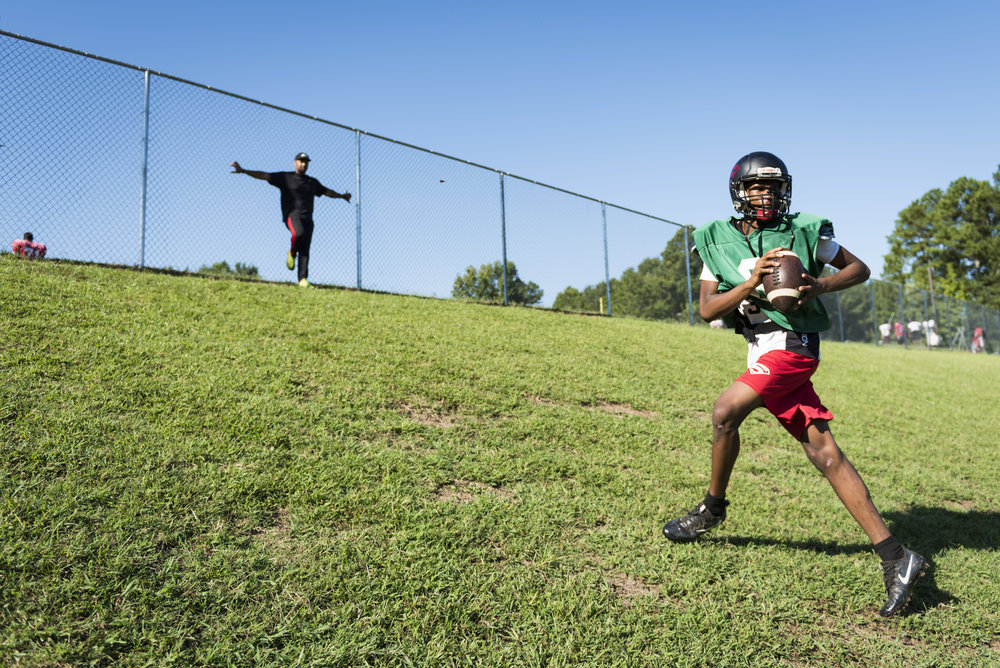 Southern Durham sophomore quarterback Omari Smith works on his footwork by running up a hill during practice.