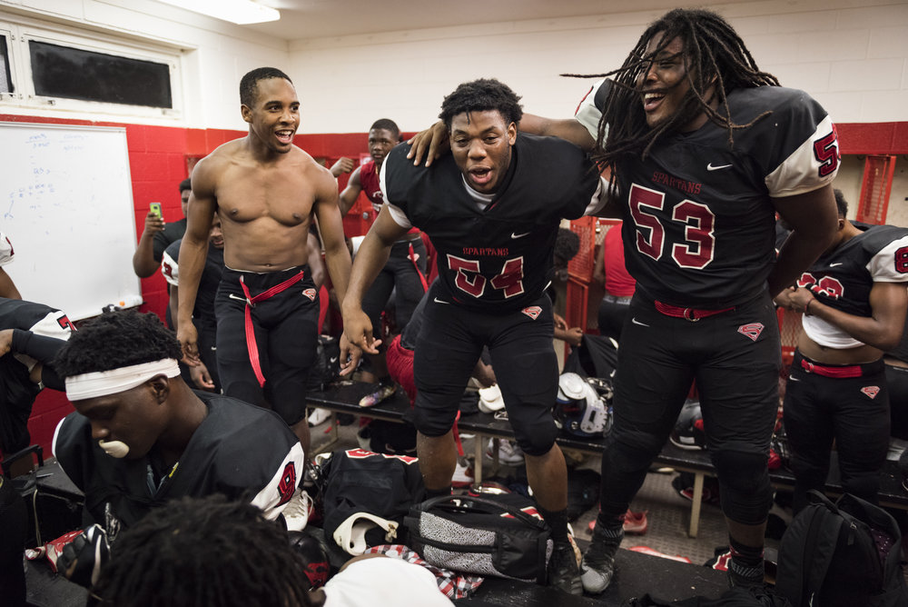 From left, Southern Durham players Curtis Justice, Deshawn Harris, and Zyon Johnson, celebrate an upset win against the No. 4 team in the region, Seventy-First High School.