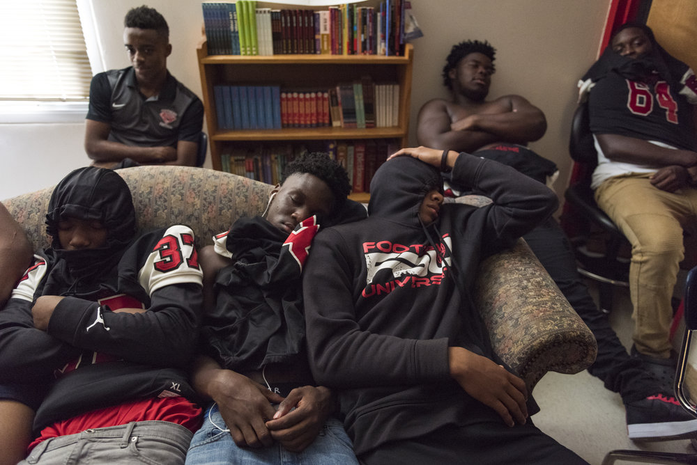 Southern Durham players take a quick nap before their game. During home game days, players usually have a team meal and then hangout in head coach Robinson's room before the game.
