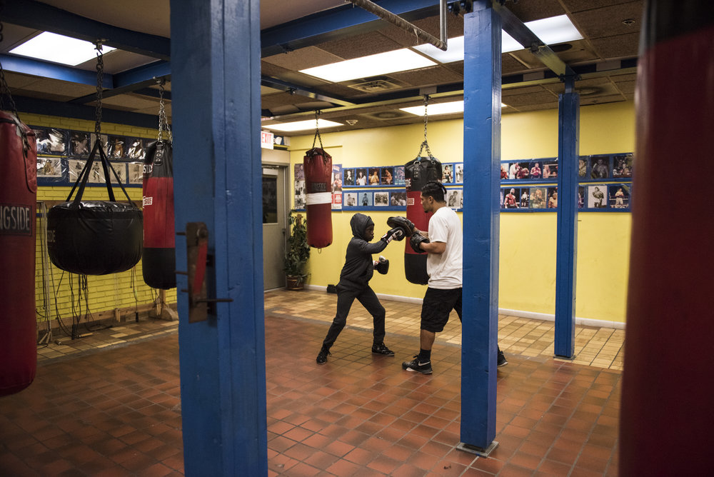 Lungz practices the mitts with professional Syracuse boxer Luis Vargas.