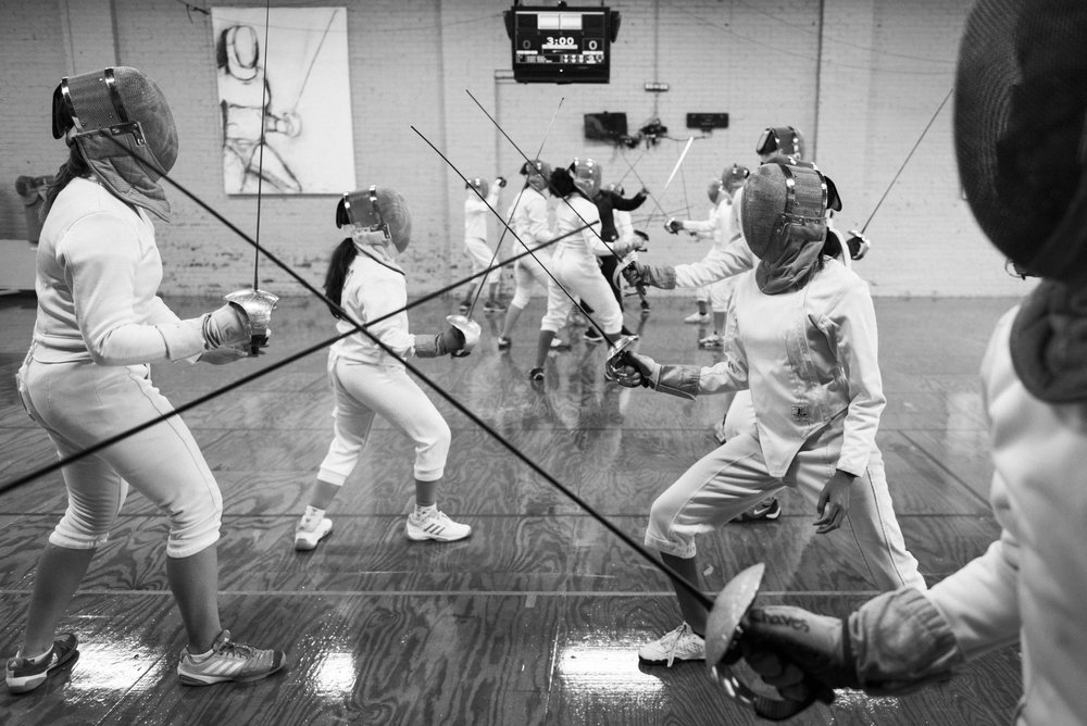 Coach Oldham's student practice at the Mid-South Fencer's Club in Durham, NC. Oldham has coached several successful fencers and currently has two students competing in the international circuit with hopes of fencing for their nation's Olympic team.