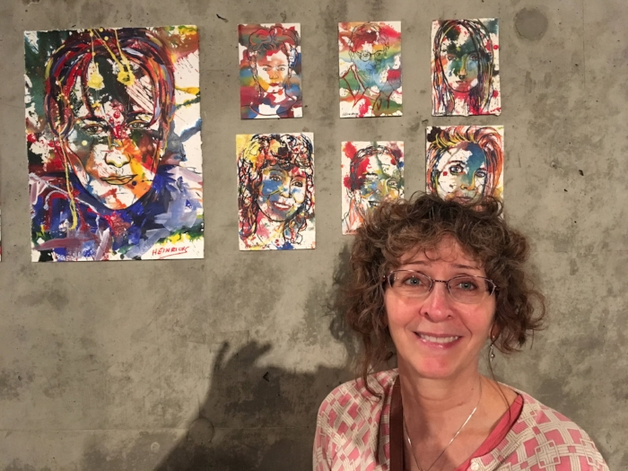 --- Ann and her portrait on the wall of FAME. ---