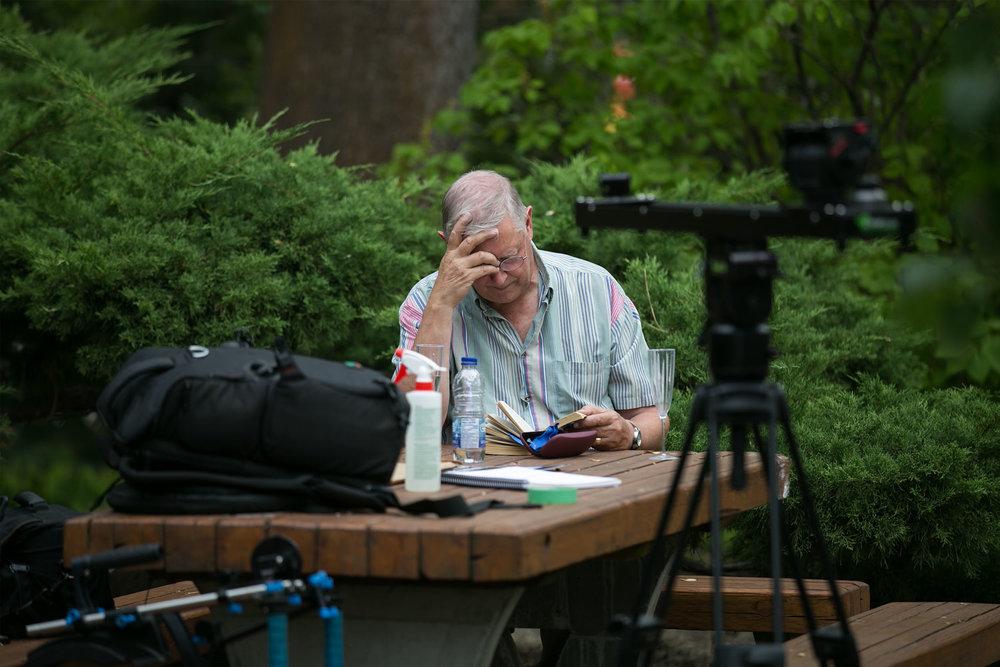 Lynn's husband studying hard on the set of Citizen X.