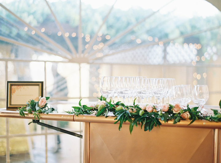 The simplest of adornments can really dress up a bar to make it really special, in this case, we used floral garlands.