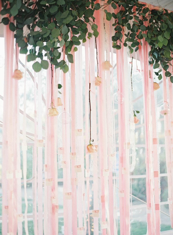 For the Escort Cards, we created a wall of hanging ribbons that we attached escort cards to, adorned with foliage and hanging blooms.  This one was a showstopper!