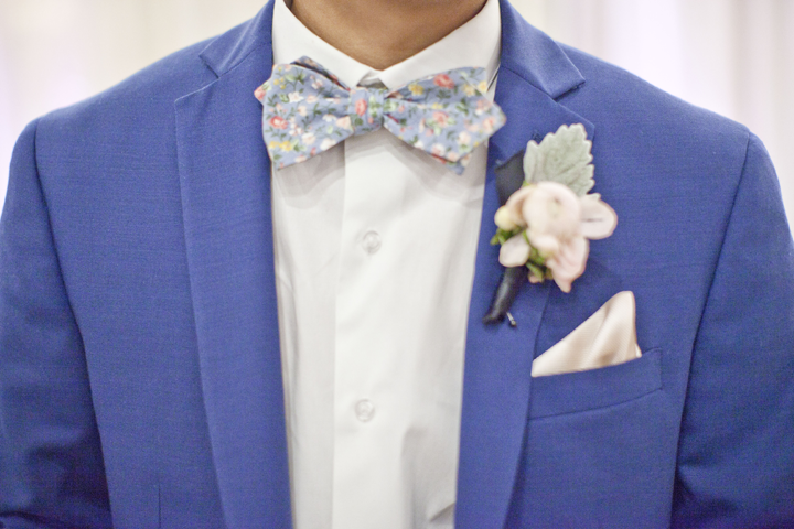 Our dapper groom with the best suit and bow tie...like ever.
