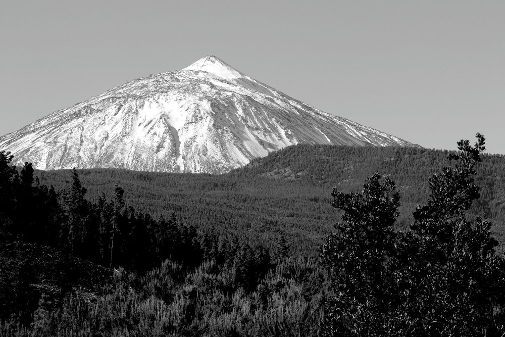 About this image: - Our background image is the Mount Teide. Standing 3718 meters tall (over 12,000 feet!), this volcano tops the island of Tenerife, in Spain. It is an exceptionally beautiful place, and it is the place that Ana calls