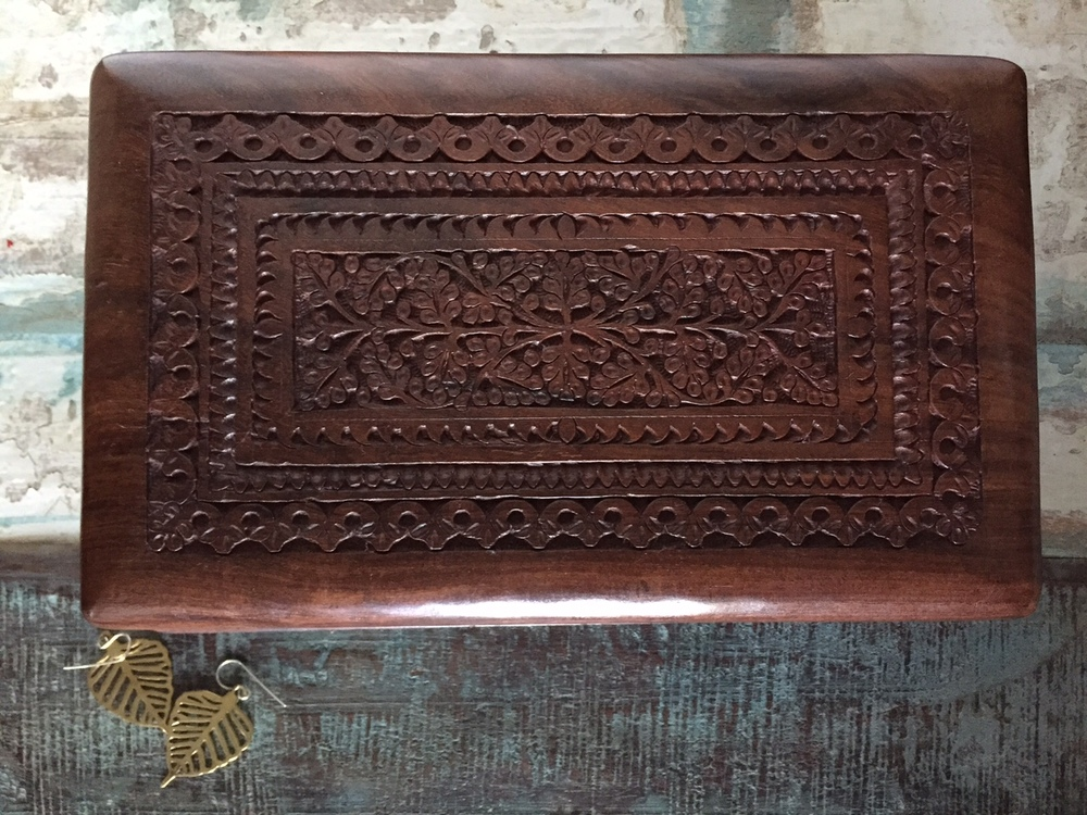 A perfectly lovely jewellery storage option! This handcarved wood box with a secret lock is made with love by artisans in India.