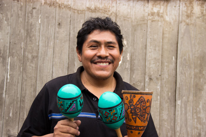 Rufino with his handcrafted instruments. Photo courtesy of Intercrafts Peru