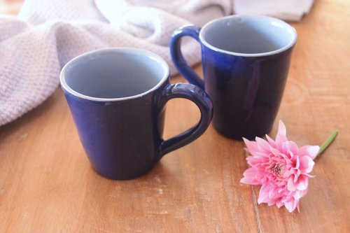 Blue on blue earthenware cups set , $36