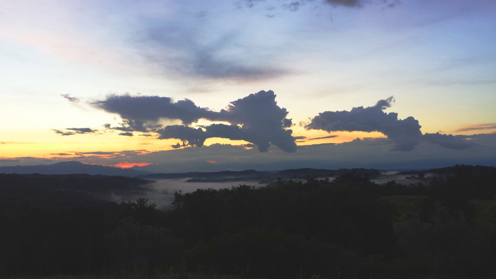 Sunset from Liverno, on top of the hills of Barbialla. Cloudy sky over tuscan countryside at dusk.