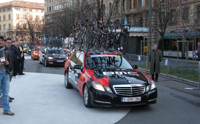They're Off! Team cars roll through Piazza Castello on their way to Sanremo