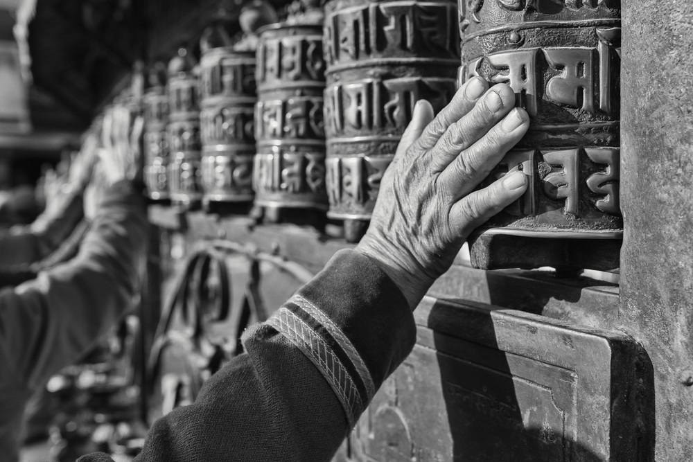 Pilgrims spinning the prayer wheels at the Swayambhu (Kathmandu/ Nepal) - Copyright: Daniel Hofmann