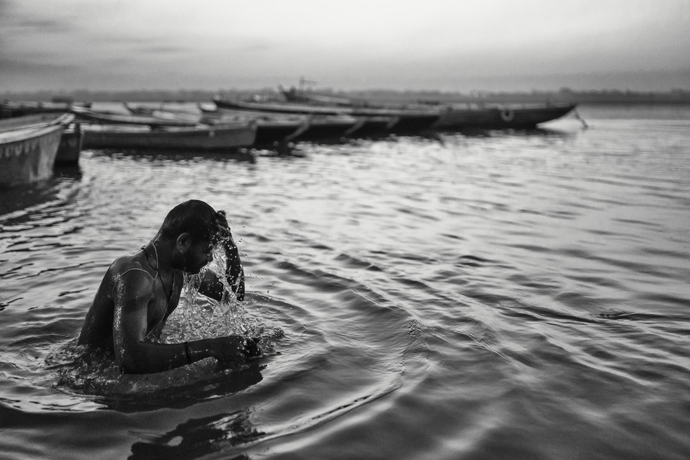 """I found this scene at the Ganges in Varanasi (India). Water is important everywhere, but here people have a very special connection to """"Mother Ganges."""" Every morning I could witness their deep devotion to this river."""