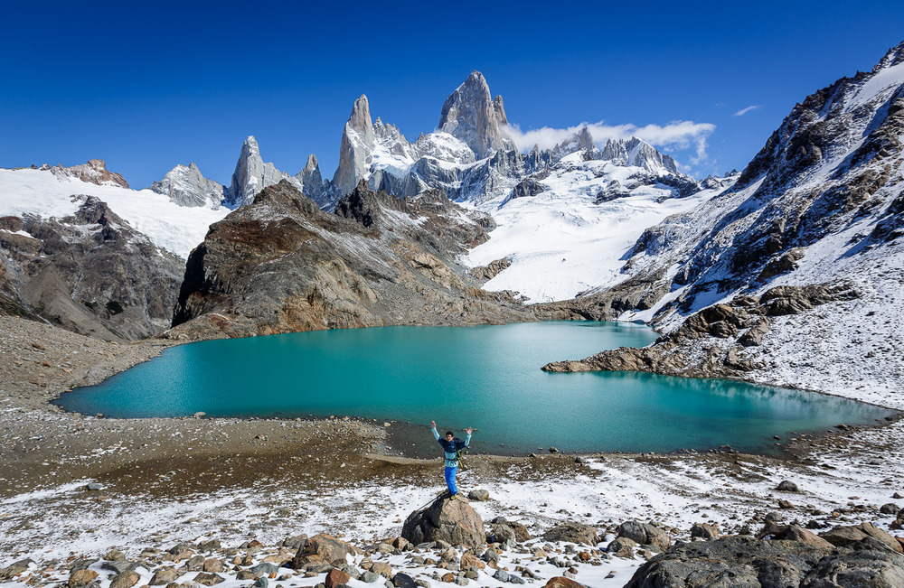 Dušan finding balance on a boulder in front of the lake and Fitz Roy!