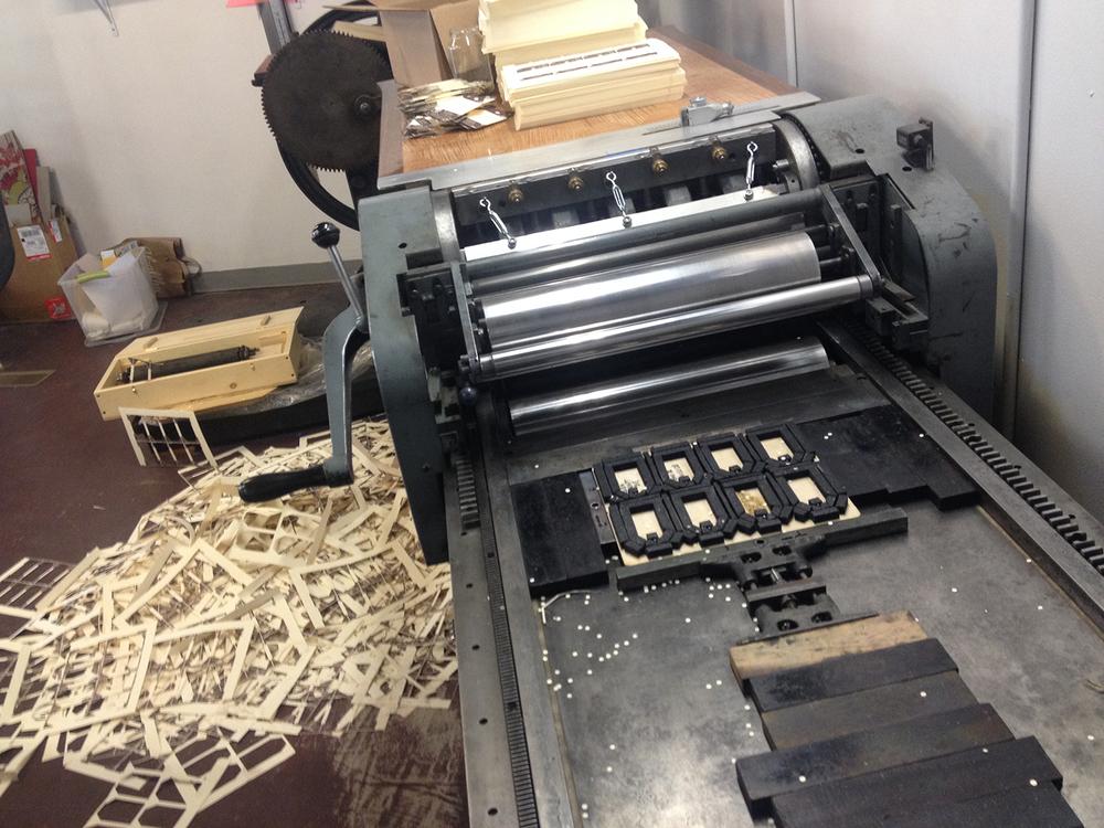 A die cutting mess. Paper scraps for 5,000 hang tags printed in house and die cut on our Vandercook Universal III... complete with handmade die jacket.
