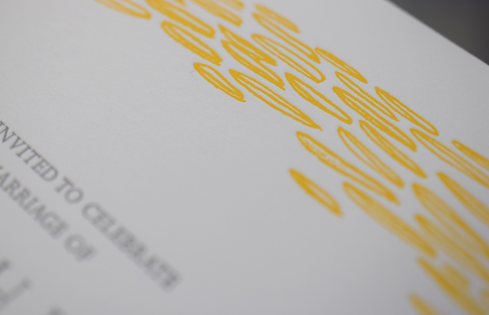 Detail of a letterpress printed wedding invitation on press today. Hand drawn patterns printed in sunny yellow. We're excited about the yellow matching envelopes.