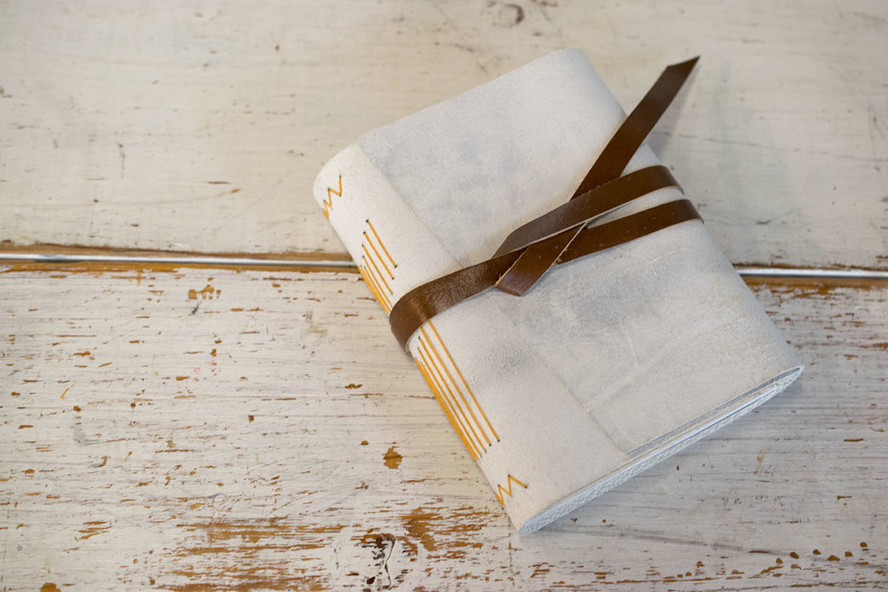 white leather journal by 7 ton co.