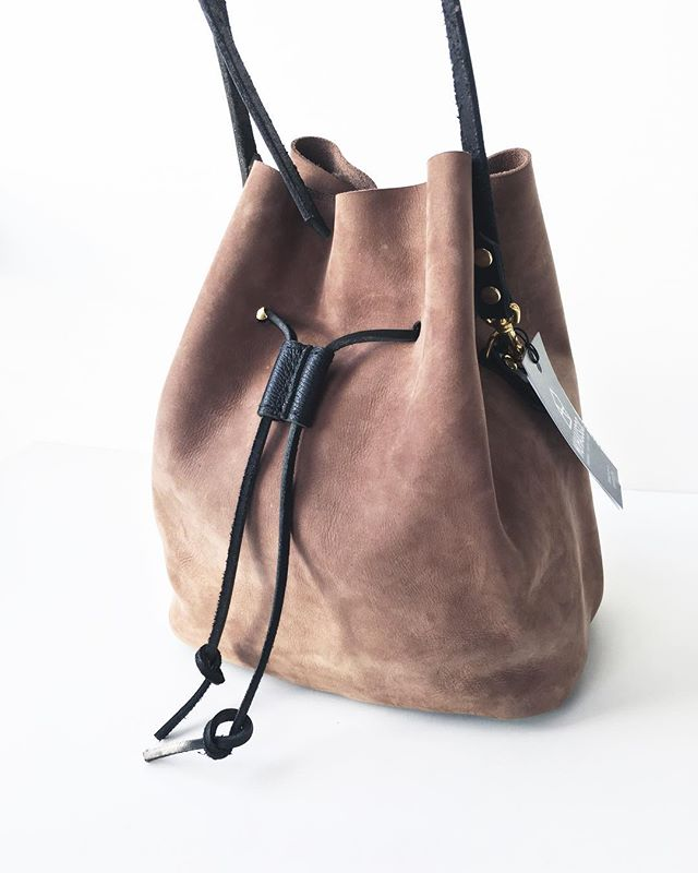 Two of a kind (one of two ever made) taupe Canberra Bucket Bags. Converts into a backpack! $235 snap this up before it's gone. Local pick up and drop off available as well as rush shipping. • • • • #torontostyle #torontofashion #tostyle #shoptoronto #shoplocal #handmade#handstitched #leather #leatherbag #womensaccessories