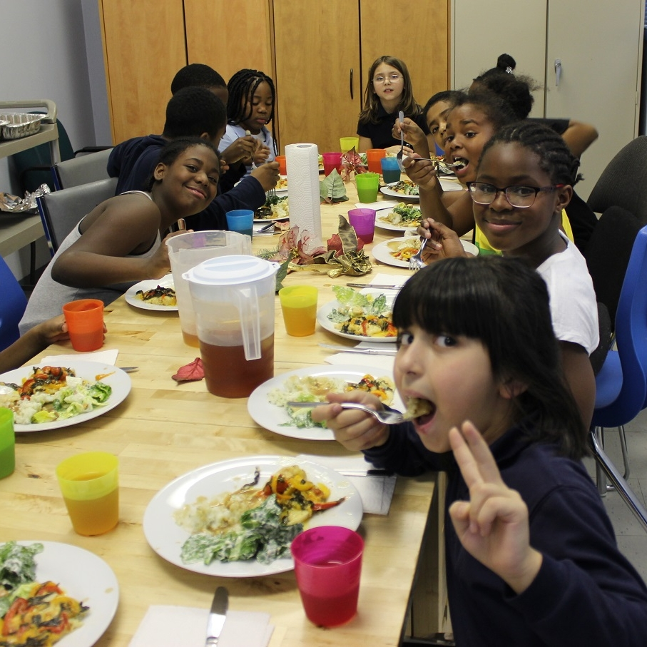 After-school program enjoying a healthy meal