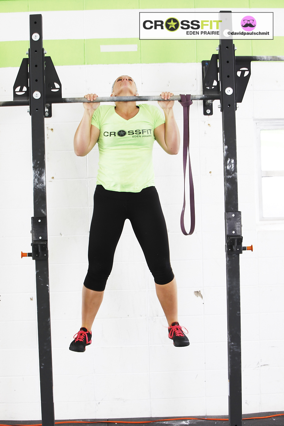 Genell H. showing a perfect RX rep with her chin above the bar...