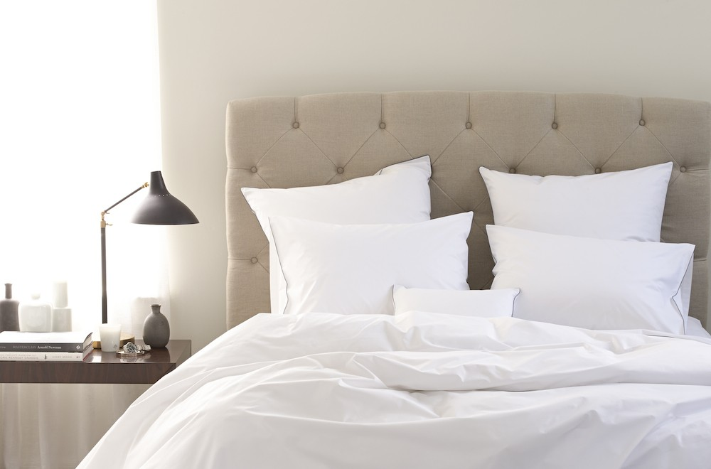 Of all the questions we get asked, there is one that we know we can expect: how to keep your bed linens as white as the day you bought them. Body oils, sweat, makeup and body products can find their way into the nooks and crannies of those pristine white threads, sticking to them and lending a yellow tone. And that's before the pets and children lend their special patina.