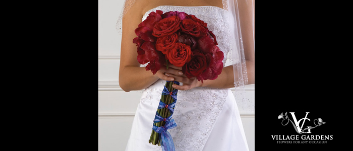 Hand-Tied Clutch Bouquet- This lovely style has the look of a freshly picked bouquet. Depending on the bride's preference, the stems can be visible or wrapped attractively in ribbon. The top of the bouquet is a cluster of flowers, round in shape, which appears to have movement and be free-flowing. The Hand-Tied Bouquet can be designed tightly like a Tussie-Mussie or in a Free Form style. One variation of the Hand-Tied Bouquet is the Presentation style.