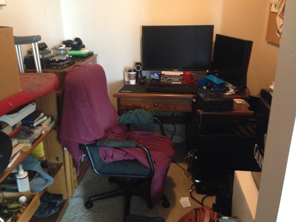Too much furniture and surface mess obscures the usefulness of this den!