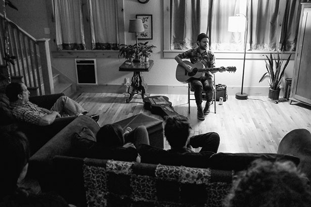 Undertow artist Will Johnson plays a South Eugene living room. Photo by Trask Bedortha.