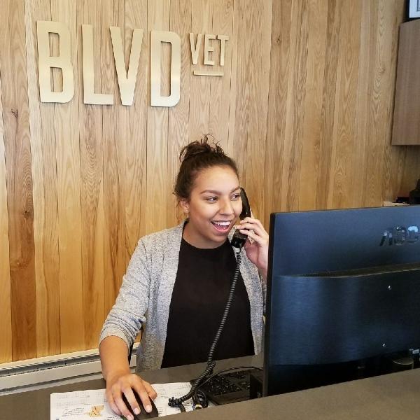 Mariah, answering client calls.