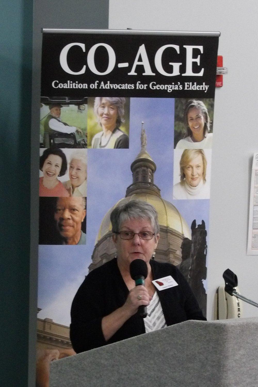 Joanne at lectern.JPG