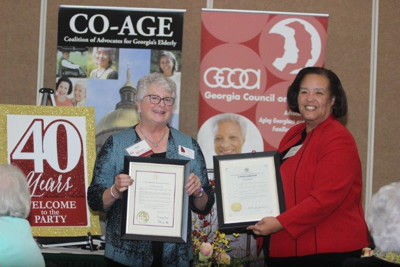 Commissioner Crittenden and Vicki with Proclamations.jpg