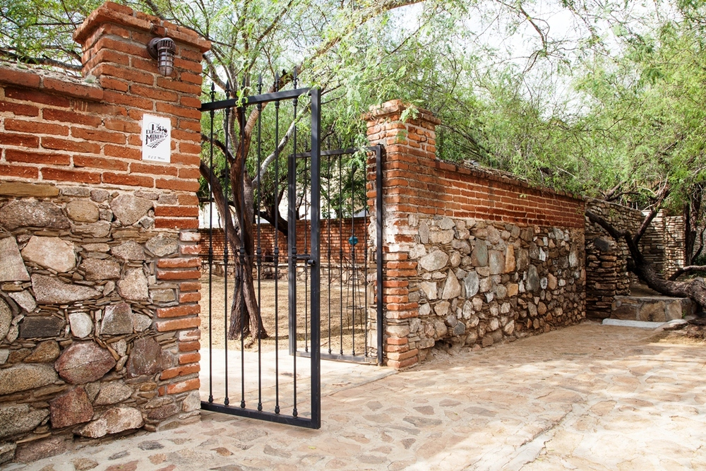 historical-bar-restaurant-el-triunfo-entrance-brick-rock-wall-baja-california-sur.jpg