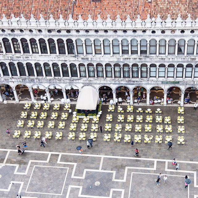 Lines, circles, umbrellas as people scurry to find cover in the Piazza San Marco #Campanile #italy #venice #ProcuratieVecchie #venezia #travel #streetphotography #travelwell #architecture