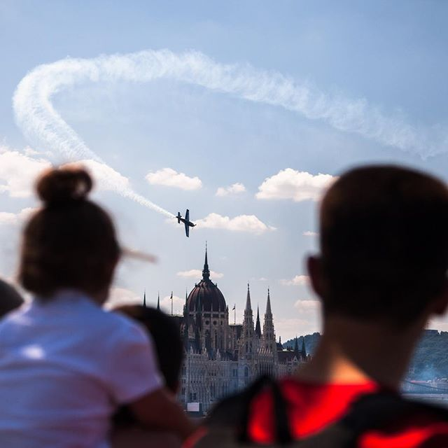 Happened upon the Red Bull Air Race World Championship while in Budapest. The planes were flying under one of the bridges and the course was in front of the Parliament building. #givesyouwings #travel #streetphotography #thisisbudapest
