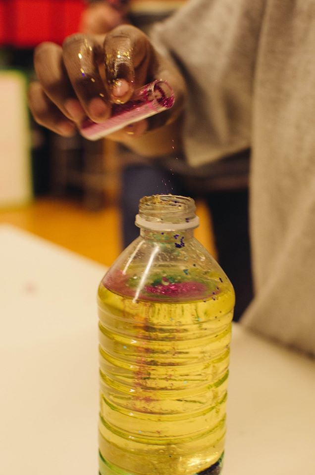 Scholar Athletes created their own lava lamps using water, oil, and food coloring.